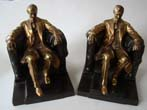 click to view detailed description of A pair of Abraham Lincoln 'sitting in the chair' bookends by the Philadelphia Manufacturing Company circa 1935